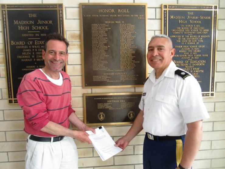 With Lt. Colonel Ulises Miranda who runs the ROTC program at the Madison Campus on Genesee Street.