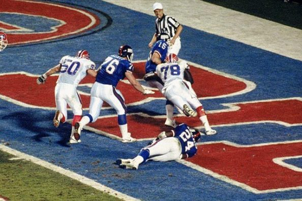 Bruce Smith sacks Giants QB Jeff Hostetler for a safety in Super Bowl XXV. (Sports Illustrated)