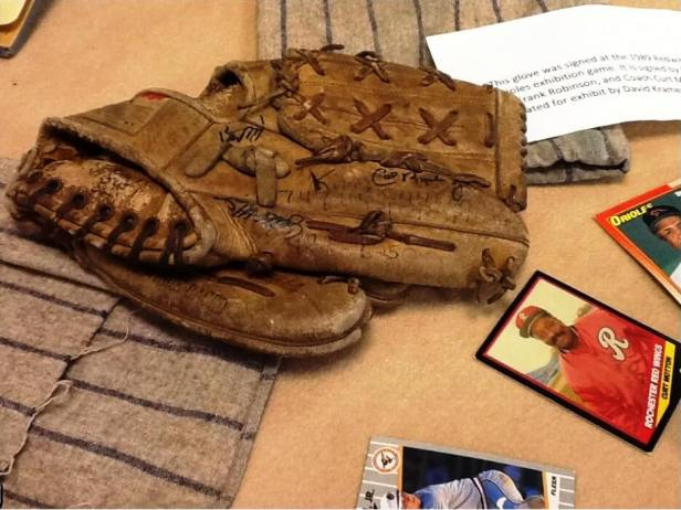 "Exhibit note: ""This glove was signed at the 1989 Redwings [sic] vs. Orioles exhibition game. It is signed by Cal Ripken Jr., Frank Robinson, and Coach Curt Motton. Donated for exhibit by David Kramer.]"