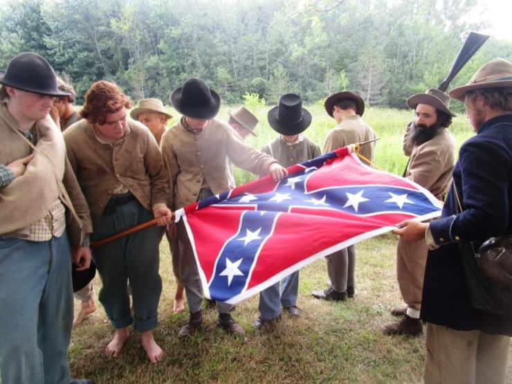 """Recreation of """"Rebel Veterans furl the Stars and Bars for the last time before starting for home"""" from The Golden Book of the Civil War: """"Monroe Wildcats"""" representing the 1st Tennessee Dismounted Cavalry. Tinker Homestead and Farm Museum 8/6/16"""