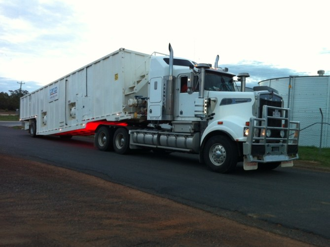Dual Compartment Mobile Dual Compartment - being towed (Tango Oilfield Rental Solutions)