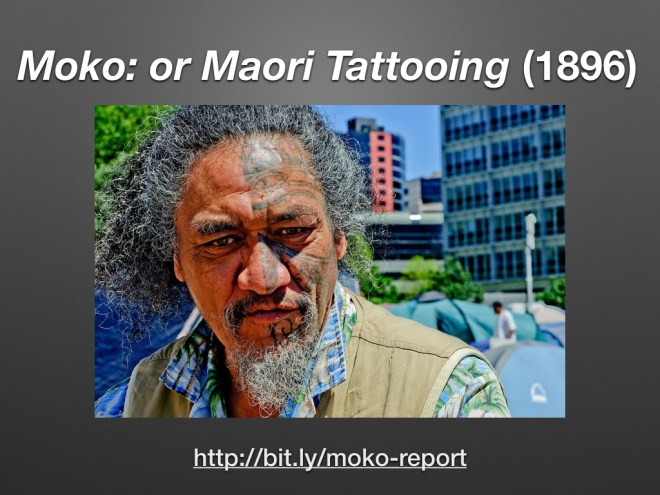 Maori man who has the right side of his face tattooed.