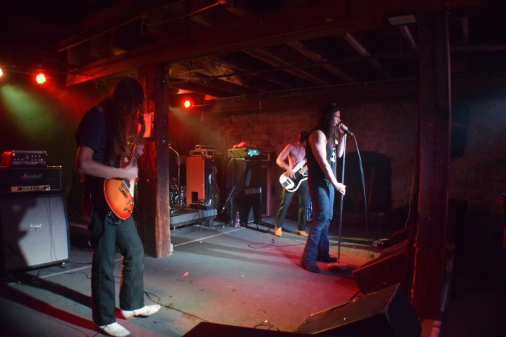 Pictured left to right: Bones (guitar), Shock (bass), and Cody (vocals) from the band Sweat Lodge performing at The Masquerade as the opening act for Monolord.