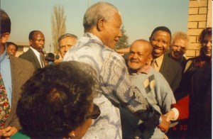 Nelson Mandela returning to Kliptown to thank the Lollan mother and family for what they did.