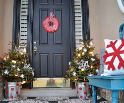 Christmas porch with trees in pails