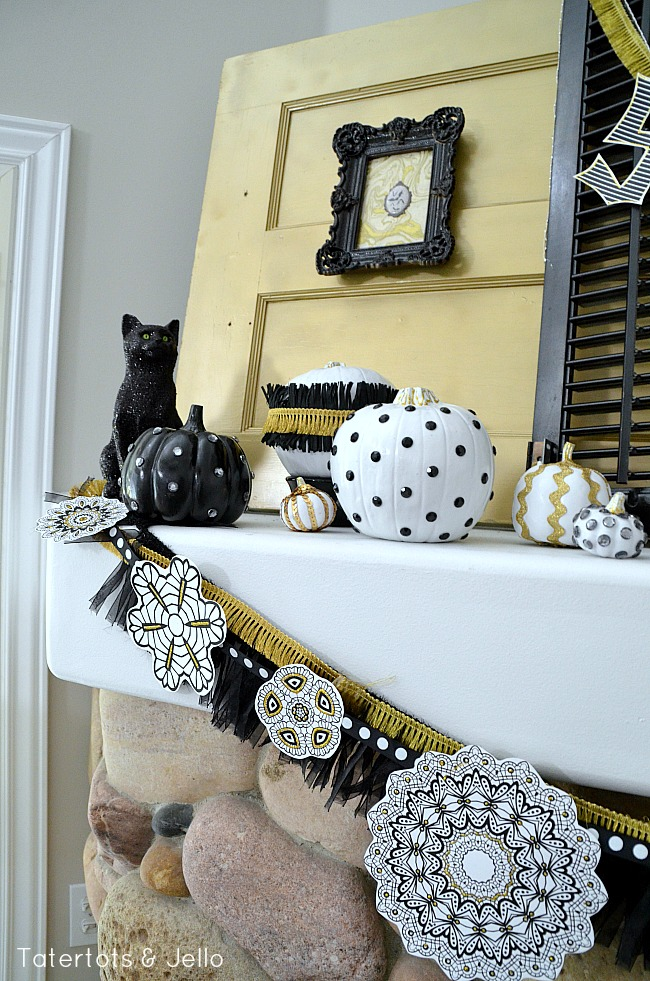 gold and black mantel at tatertotsandjello