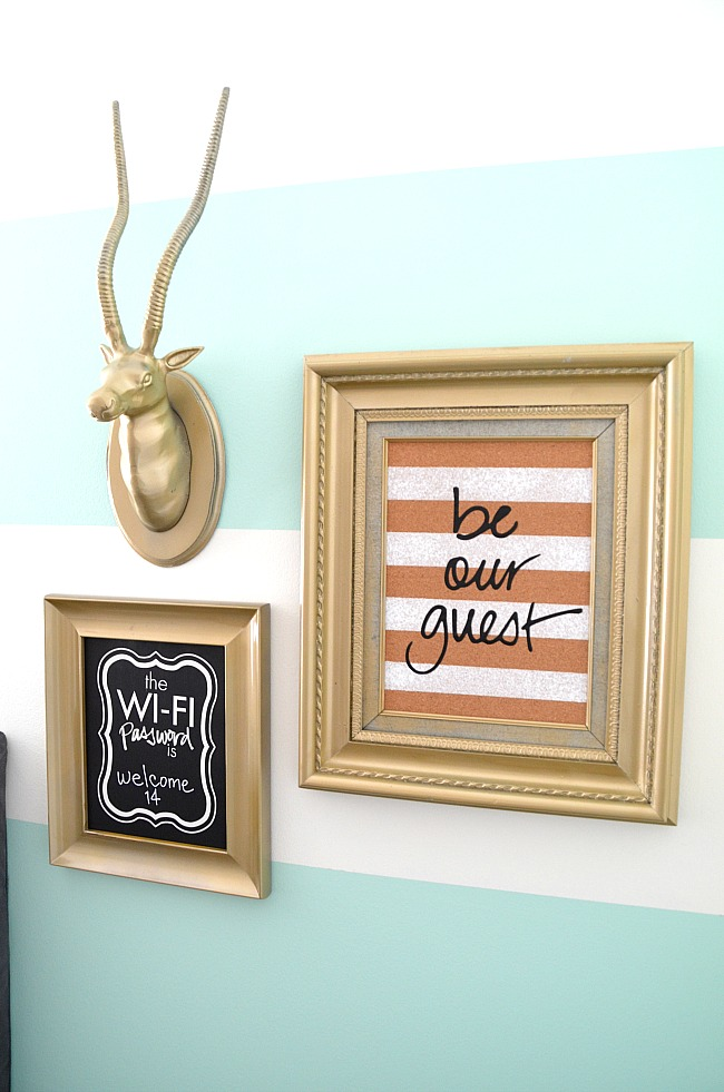 Guest Bedroom Inspiration Striped Wall Gallery Frames Wifi Password Typography Chalk Paint Gold Frames Antlers Blue White Orange Welcome