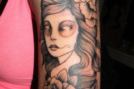 girls arm tattoo 2