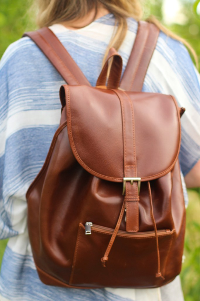 Picture of blogger, Tazia Lynne, showing the WILSONS LEATHER RUGGED LEATHER BACKPACK.