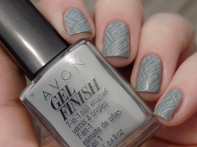 Avon Gel Finish Head In Clouds Nail Polish Swatch in Artificial Lighting stamped with XYZ26 and BP Grey