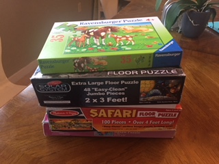 stack of games and puzzles