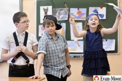 Students playing vocabulary charades in classroom