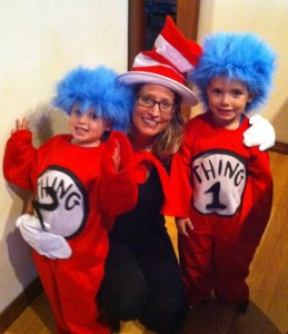 Mom in Cat in the Hat costume with two children dressed as thing 1 and thing 2