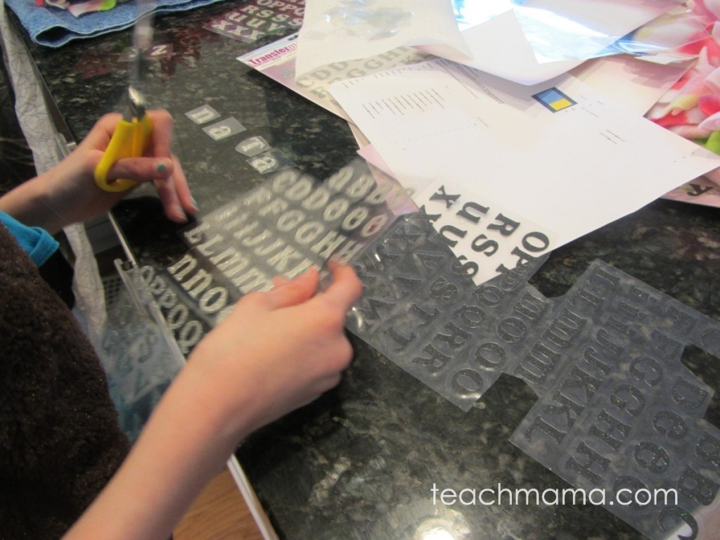 girl cutting iron-on letters out