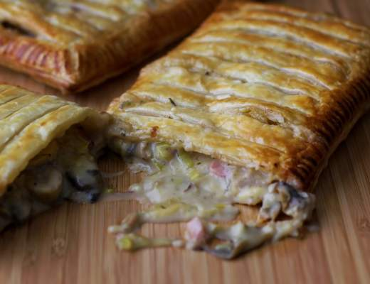 Free form pie with a creamy ham and leek filling spilling out from the middle