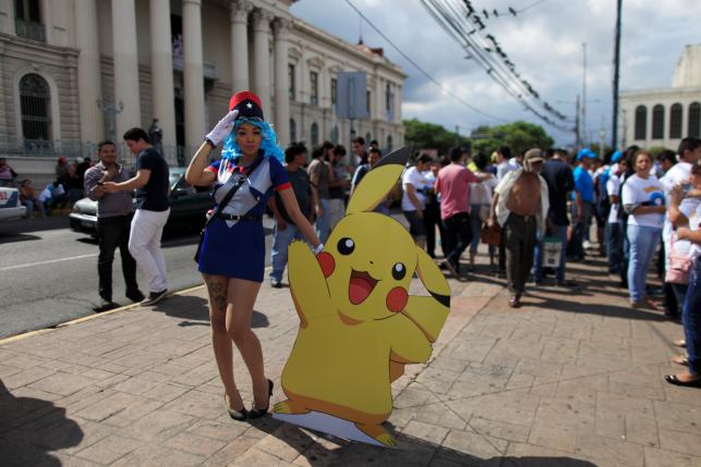 """Cosplayer dressed as a character of the augmented reality mobile game """"Pokemon Go"""" by Nintendo participate in a """"poketour"""" organized by the municipality in San Salvador, El Salvador July 23, 2016. REUTERS/Jose Cabezas"""