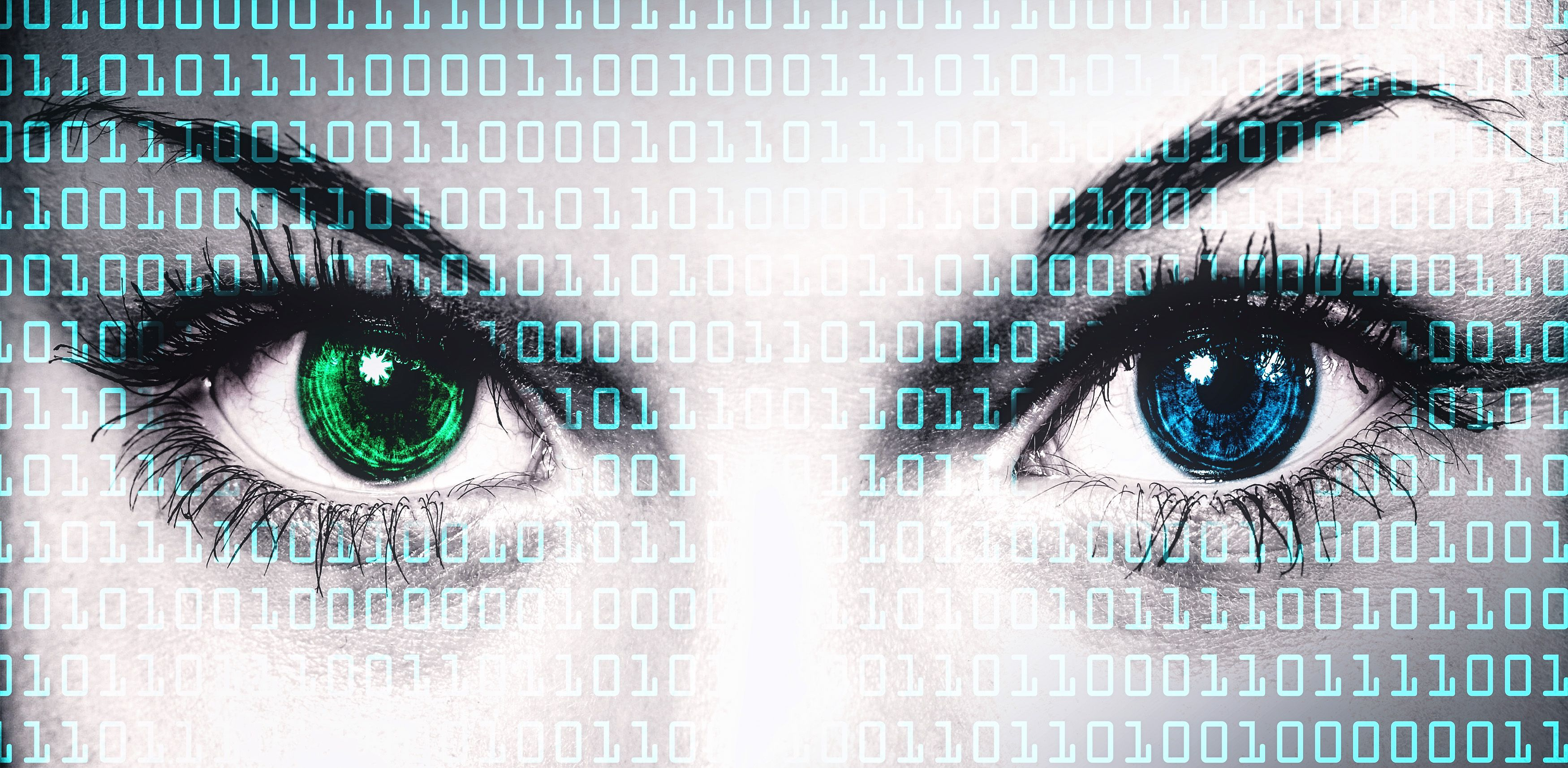 Binary computer code on human face - Online privacy concept