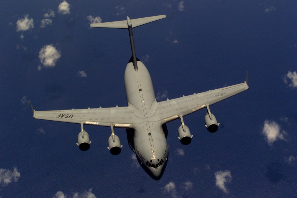 A C-17 Globemaster III from the 437th Air Wing, Charleston Air Force Base, South Carolina, flies away from a KC-10 Extender after being refueled off the coast of North Carolina. During Rodeo 2000, teams from all over the world will compete in areas including airdrop, aerial refueling, aircraft navigation, special tactics, short field landings, cargo loading, engine running on/offloads, aeromedical evacuations and security forces operations. From May 6 to 13, more than 80 aircraft representing more than 100 teams from 17 countries will bring in about 3,500 competitors, observers, umpires, and support people to Pope AFB, NC. USAF Photo by Staff Sergeant Sean M. Worrell.