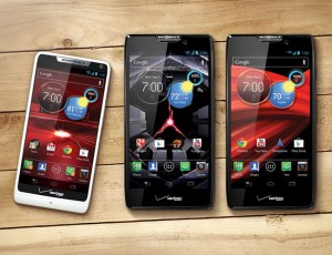 The Droid RAZR M, Droid RAZR HD and Droid RAZR Maxx HD placed on top of a wooded table