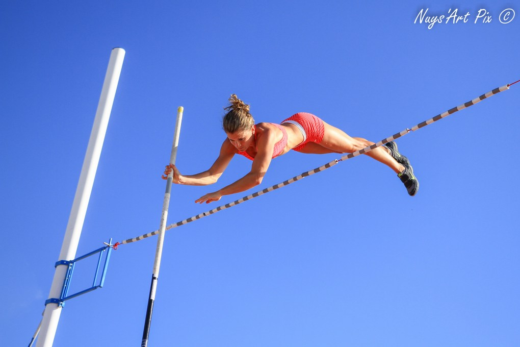 pole vaulter sailing over the bar