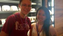 Taylor Blowers, 16 and Bina Lee, 16 smile for women's rights in Starbucks. Photo courtesy of Naima Fonrose