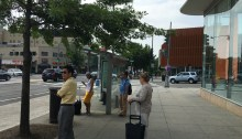 People wait for the bus outside the Tenleytown Metro. Photo credit by Eli Siegman.