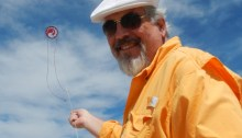 Announcer Ron Gibian at a kite festival. Photo by Takaku Barresi