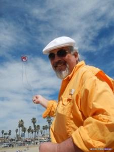 Ron Gibian flies his kite at a kite festival. Photo credit Takaku Barresi.