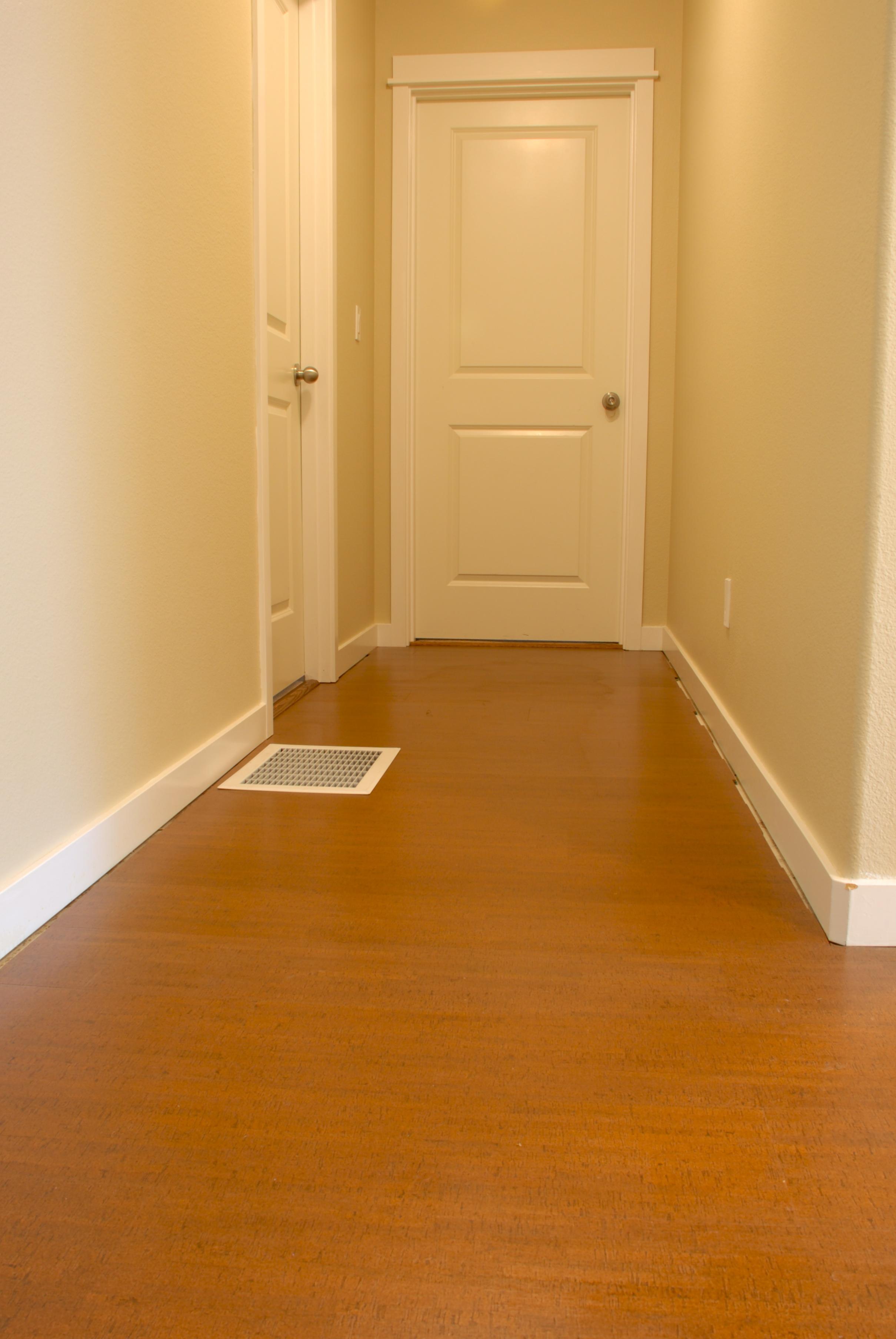 cork floor redux cork flooring kitchen Hallway before shoe molding