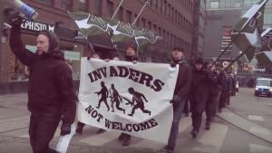 Members of  the neo-Nazi group Suomen Vastarintaliike SVL (Finnish Resistance Movement) march through Helsinki. Credit: YouTube.