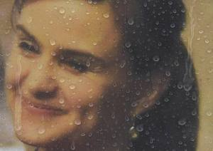 Rain drops land on a framed photograph of murdered Labour Party MP Jo Cox, who was shot dead in Birstall, at Parliament Square in London, Britain June 20, 2016. REUTERS/Toby Melville/Files