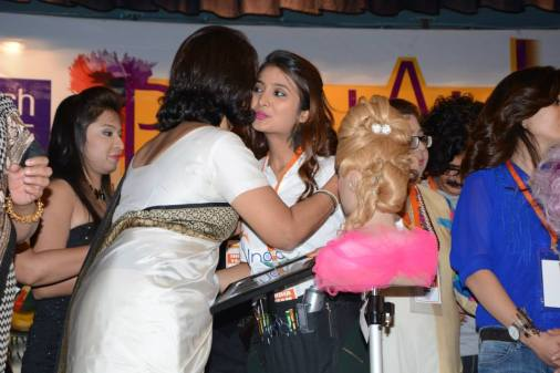 Nikisha Bhatia being felicitated by an award at a competition