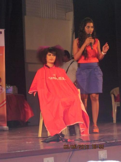 Nikisha Bhatia delivering a speech at a fashion event