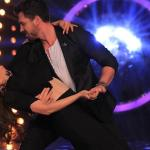 Maksim engages in an elegant dance move with madhuri