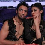 Puneet in a teasing pose with Mouni
