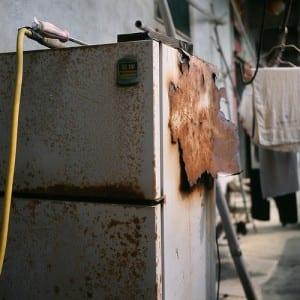 old broken down fridge