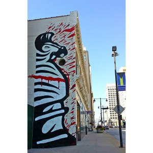 "Phil Shafer. ""Angry Zebra"" (mural), 2014. 12th and Grand. Spray paint on concrete 14' x 50'"