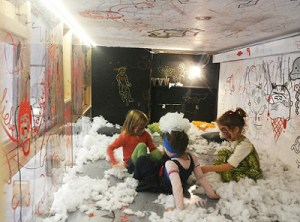 kids take over the child-height mezzanine gallery overlooking Aviatrix's café