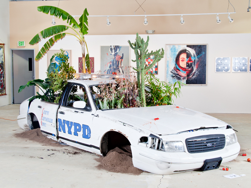 Jordan Weber, American Dreamers (Phase 2), 2015, Cop car, Ferguson earth, fruit plants, cactus, tomatoes, Dimensions varied (Photo Credit Manifest Justice)