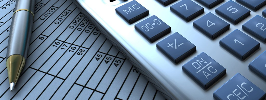 Pen, calculator and spreadsheet