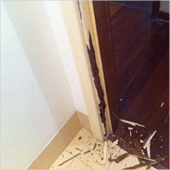 Picture shows termites have damaged door frames.