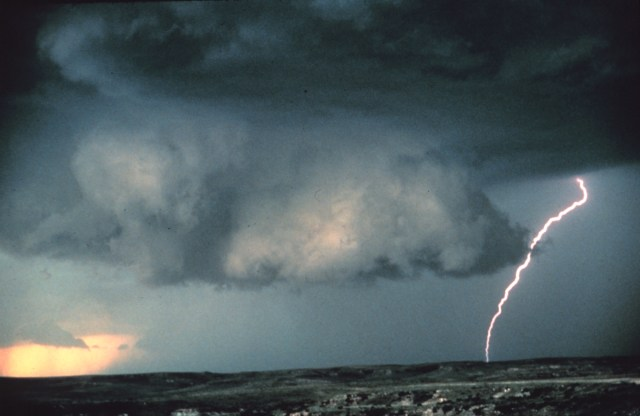 """""""Wall cloud with lightning - NOAA"""" by Brad Smull, NOAA Photo Library, NOAA Central Library; OAR/ERL/National Severe Storms Laboratory (NSSL) - nssl0092, National Severe Storms Laboratory (NSSL) Collection http://www.photolib.noaa.gov/nssl/nssl0092.htm. Licensed under Public Domain via Wikimedia Commons - https://commons.wikimedia.org/wiki/File:Wall_cloud_with_lightning_-_NOAA.jpg#/media/File:Wall_cloud_with_lightning_-_NOAA.jpg"""