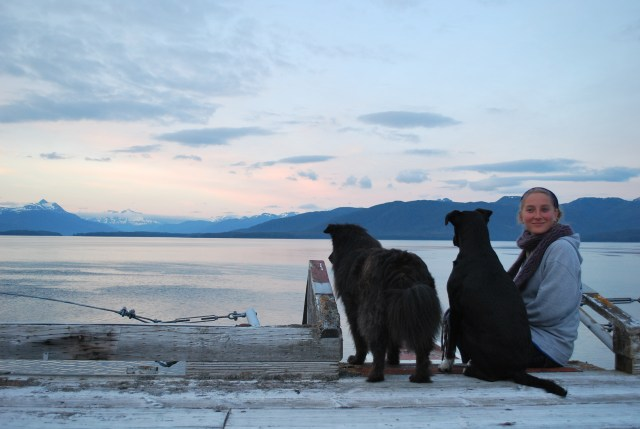 Michelle Fournet enjoys a midnight sunset from the lighthouse helicopter pad with pups Vista and Zoey.
