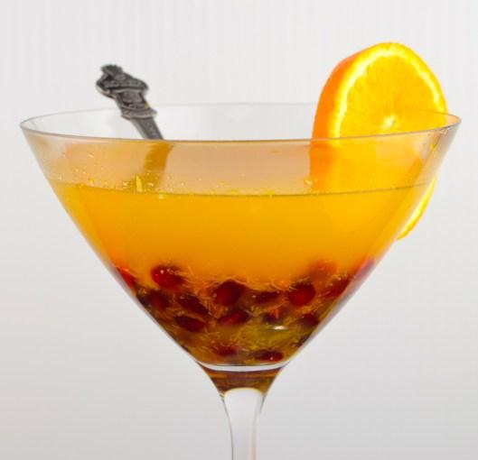 citrus arak cocktail with pomegranates
