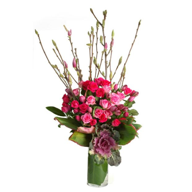 Arrangement-of-roses-seasonal-branches-in-vase