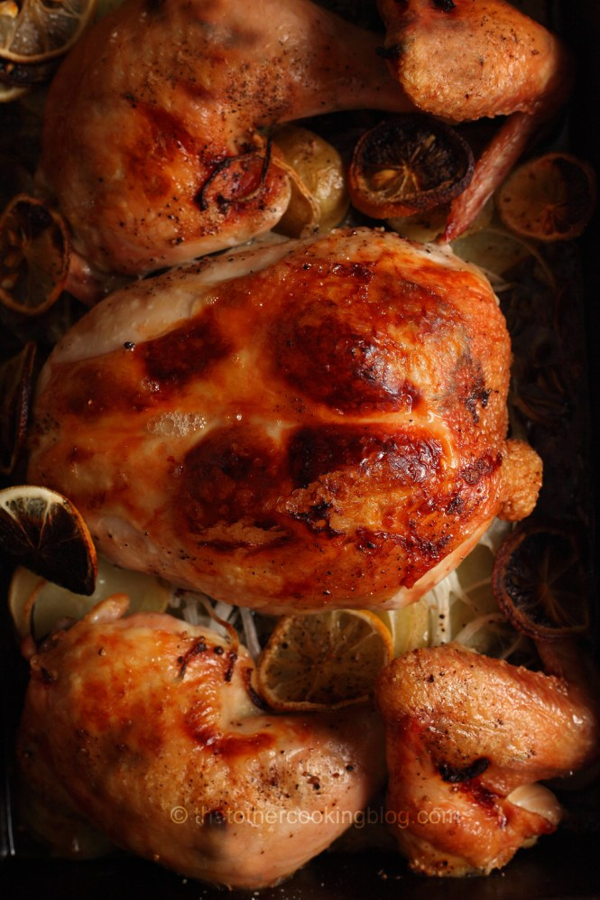 Roasted Chicken Over Onions Lemons And Potatoes