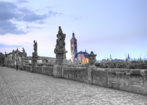 statues on bridge with church in background, Kutna Hora