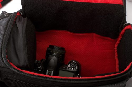 The main compartment of the Python, with no dividers, holding a single dSLR for scale. You can hear the echos.