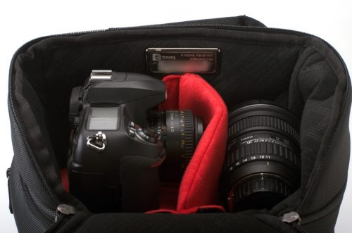 The Python holds a lot of gear. This is to top pocket, holding a full-sized dSLR and two lenses.