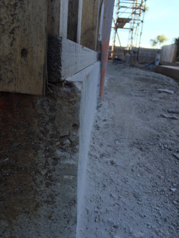 The slab jutting out by 25 ml along the length of the westside, a potential heat leak in a passively heated house.